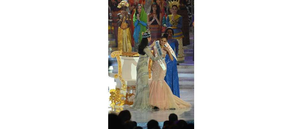 New Miss World, Megan Young (C) from the Philippines is congratulated by outgoing Miss World Yu Wenxia (L) after winning the crown, at the Miss World 2013 finals in Nusa Dua, in Indonesia's resort island of Bali on September 28, 2013
