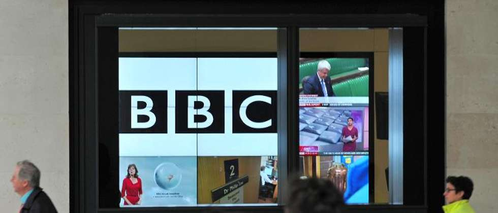 A BBC logo is pictured on a television screen inside the BBC's New Broadcasting House office in central London, on November 12, 2012 - Photo: Carl Court /AFP