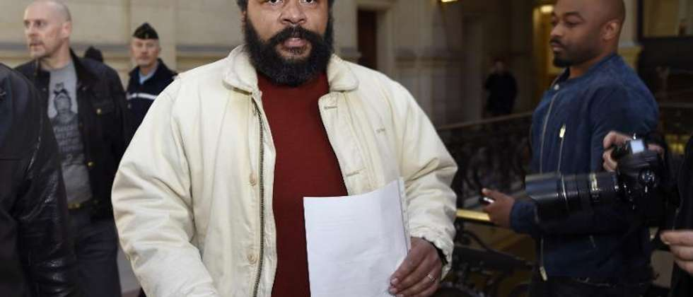 French comedian Dieudonne (centre) arrives at a courthouse in Paris, on March 12, 2015 ( Loic Venance (AFP) )
