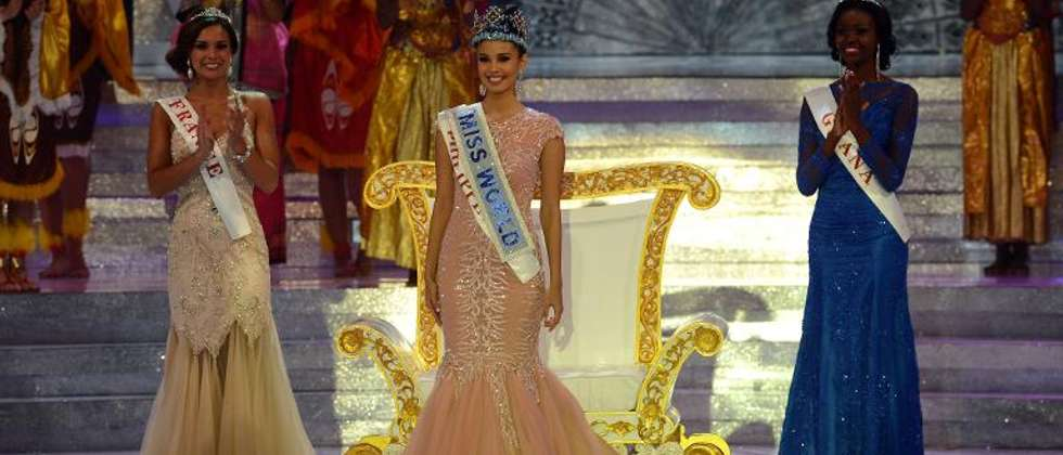 The new Miss World, Megan Young (C), from the Philippines stands after winning the crown during the Miss World 2013 finals in Nusa Dua, on Indonesia's resort island of Bali on September 28, 2013 (Romeo Gacad (AFP))