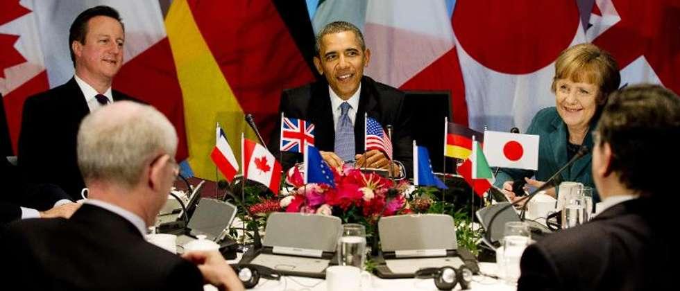 (De gauche à droite) Le Premier ministre britannique David Cameron, le président américain Barack Obama et la Chancelière allemande Angela Merkel au Sommet du G7 à La Haye le 24 mars 2014 ( Jerry Lampen (POOL/AFP) )