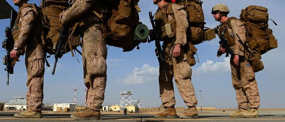 US Marines board a plane to Kandahar as British and US forces withdraw from the Camp Bastion-Leatherneck complex in Afghanistan's Helmand province in October 2014 ( Wakil Kohsar (AFP/File) )