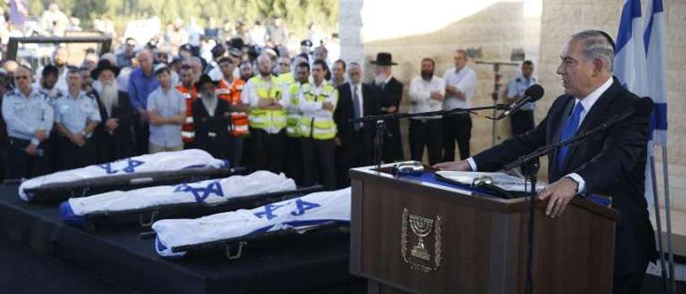 Israeli Prime Minister Benjamin Netanyahu delivers a speech on July 1, 2014 in the cemetery of Modiin during the funeral of Gilad Shaer and Naftali Frenkel, both 16, and 19-year-old Eyal Ifrach ( Baz Ratner (POOL/AFP) )