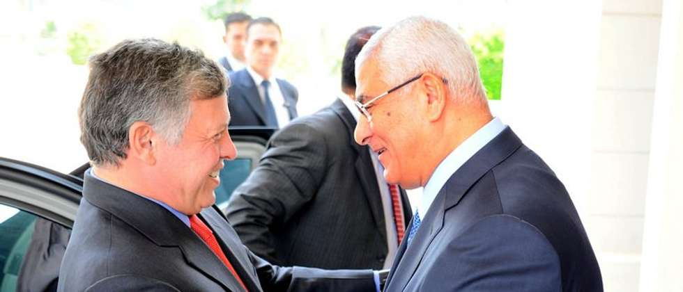 Egypt's interim president Adly Mansour (right) welcomes Jordan's King Abdullah II in Cairo, on July 21, 2013 ( Egyptian Presidency/AFP )