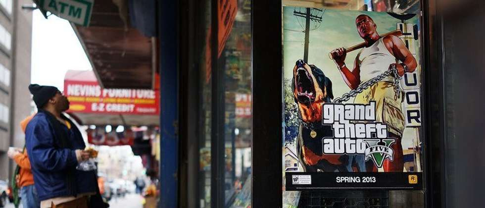 An advertisement for the new Grand Theft Auto displayed outside of a gaming store on January 11, 2013 in New York City ( Spencer Platt (Getty Images/AFP/File) )
