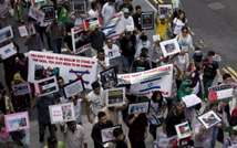 People march in Hong Kong to protest against Israel's military campaign in Gaza on July 13, 2014 ( AFP/ALEX OGLE )