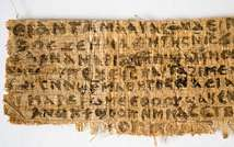 Hollis Professor of Divinity at the Harvard Divinity School in Cambridge, Massachusetts, shows the front side of a fourth-century papyrus fragment. ( AFP Photo / Karen L. King )