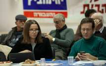 Israeli opposition leader and current leader of the Labor Part Shelly Yachimovitch sits with fellow part member Isaac Herzog ( Facebook )