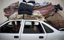 A Palestinian family head home with their belongings in Gaza on August 27, 2014 ( AFP )