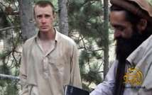 This still image provided on December 7, 2010 by IntelCenter shows the Taliban associated video production group Manba al-Jihad release of someone that appears to be US soldier Bowe Bergdahl (L) (IntelCenter/AFP/File)