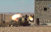 An image grab taken from a video released by Aamaq News, a Youtube channel that posts videos from areas under the Islamic State group's control, on September 23, 2014, purportedly shows an IS militant near the Syrian Kurdish town of Ain al-Arab (Aamaq News/AFP/File)