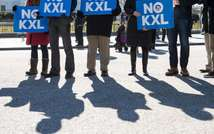 Demonstrators hold signs against the proposed Keystone XL pipeline in front of the White House in Washington, DC, on January 28, 2015 (Nicholas Kamm (AFP/File))