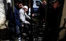 Former Nazi death camp officer Oskar Groening leaves the court after the first day of his trial in Lueneburg, northern Germany,  on April 21, 2015 (Ronny Hartmann (AFP))