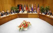 """La table des négociations lors d'une réunion """"5+1"""" (Allemagne, Chine, Etats-Unis, France, Royaume-Uni et Russie) et l'Iran à Vienne, en mars 2014 ( Dieter Nagl (AFP/Archives) )"""