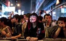 Des manifestants prodémocratie le 19 octobre 2014 dans le quartie Mongkok à Hong Kong (Alex Ogle (AFP))