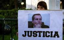 """A woman holds a sign reading """"Justice"""" during a demonstration in Buenos Aires on January 26, 2015, following the murder of Argentine public prosecutor Alberto Nisman (Alejandro Pagni (AFP))"""