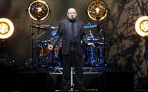 """British singer Joe Cocker performs on stage during the """"Fire it up tour"""" concert, on April 6, 2013 in Nice, southeastern France (Valery Hache (AFP/File))"""