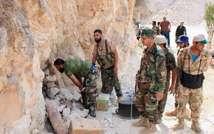 جنود من قوات النظام قرب حماة في 15 ايلول/سبتمبر 2014 (ا ف ب/ارشيف)