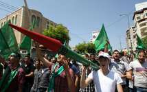 A Palestinian supporter of the Hamas Islamist movement holds a mock rocket during a rally on August 29, 2014 in the West Bank town of Hebron (Hazem Bader (AFP/File))