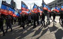 People carry flags of the self-proclaimed Donetsk People's Republic during a ceremony for the presentation of the DPR flag at the Lenin square of Donetsk, on October 19, 2014 ( Dominique Faget (AFP/File) )
