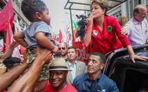 Brazilian president and presidential candidate for the Workers Party, Dilma Rousseff (R) greets a child in Porto Alegre, Brazil, on October 25, 2014 (Jefferson Bernardes (AFP))