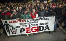 A picture taken on December 15, 2014 shows supporters of the PEGIDA movement taking part in a rally in Dresden, eastern Germany ( Jens Schlueter (AFP/File) )