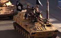 A screen grab taken from a video released on July 1, 2014, allegedly shows members of the IS (Islamic State) parading on top of a tank on a street in the northern rebel-held Syrian city of Raqa ( - (Welayat Raqa/AFP/File) )