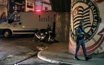 A policeman patrols outside the Corinthians fans headquarters, in Vila dos Remedios, west of Sao Paulo after a shooting that left eight people dead on April 19, 2015 ( Fernando Neves (Brazil Photo Press/AFP) )