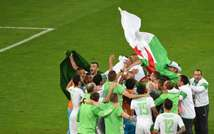 Algeria's players celebrate after their team's victory in the Group H football match between Algeria and Russia at The Baixada Arena in Curitiba on June 26, 2014, during the 2014 FIFA World Cup ( Pedro Ugarte (AFP) )