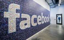 A logo created from pictures of Facebook users worldwide is pictured in the company's Data Center, on November 7, 2013 in Lulea ( Jonathan Nackstrand (AFP/File) )