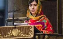 Pakistani schoolgirl Malala Yousafzai -- who survived being shot in the head by the Taliban -- addresses the congregation at Westminster Abbey in London on March 10, 2014 ( Arthur Edwards (POOL/AFP/File) )