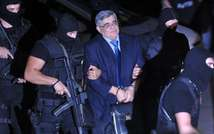 The leader of ultra-right wing Golden Dawn party Nikos Michaloliakos (c) is escorted by masked police to an  Athens court on October 2, 2013 ( Louisa Gouliamaki  (AFP) )