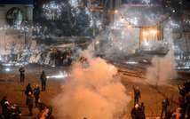A smoke grenade explodes duringclashes between police and protesters in central Kiev on January 20, 2014 ( Vasily Maximov (AFP) )