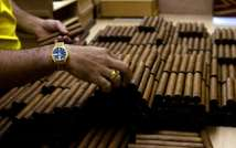 Six luxury humidors, packed with Montecristo and other prestigious cigars, have fetched more than $1.1 million at the gala closing the 16th annual Cigar Festival in Havana (Luis Acosta (AFP/File))