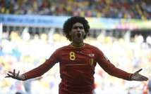 Belgium's midfielder Marouane Fellaini celebrates after scoring during a Group H football match between Belgium and Algeria at the Mineirao Stadium in Belo Horizonte during the 2014 FIFA World Cup on June 17, 2014 ( Martin Bureau (AFP) )