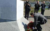 Milorad Dodik, president of the Republika Srpska (the Bosnian Serb entity), lays flowers at the memorial cemetery in Potocari, near Srebrenica, on April 16, 2015 ( AFP/File )