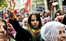 A Kurdish woman flashes the victory sign during a rally on November 1 , 2014 along Istiklal Avenue in Istanbul, as part of an international day organised in support of Kurdish fighters trying to repel the Islamic State militants in Kobane, Syrian (Ozan Kose (AFP))