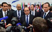 French President Francois Hollande (C) speaks to the press as he arrives on October 8, 2014 in Milan (Giuseppe Cacace (AFP))