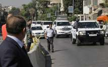 Vehicles carrying UN chemical weapons experts leave a hotel in Damascus on September 29, 2013 ( Louai Beshara (AFP) )