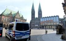 A police car pictured in the square outside the city hall in Bremen, northwestern Germany, on February 28, 2015. Bremen police have specifically warned about Islamic terrorists at large in the Hanseatic city (Carmen Jaspersen (DPA/AFP))