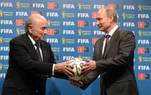 Vladimir Putin has slammed the arrests of top FIFA delegates in a US probe as an attempt by Washington to oust Sepp Blatter as head of the organisation (Aleksey Nikolskyi (RIA Novosti pool/AFP))