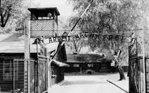"Auschwitz concentration camp gate with the inscription ""Arbeit macht frei"", after its liberation by Soviet troops, in a photo taken on April 1945 ( AFP/File )"