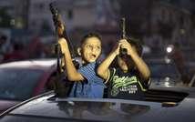 Des enfants célèbrent l'annonce d'un cessez-le-feu, le 26 août 2014 dans les rues de Gaza ( Mahmud Hams (AFP) )