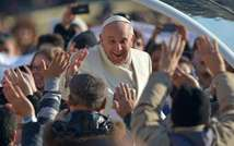 Pope Francis greets the crowd as he arrives for his general audience at St Peter's square on December 11, 2013 at the Vatican ( Vincenzo Pinto (AFP) )