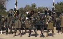 Image issue d'une vidéo de Boko Haram montrant le chef islamiste Abubakar Shekau (c) et d'autres combattants, le 31 octobre 2014 ( - (Boko Haram/AFP) )