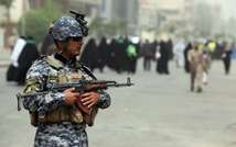 File picture shows an Iraqi soldier guarding  a main road in Baghdad ( Ahmad al-Rubaye (AFP/File) )