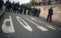 Police guard the route of a Hungarian Roma march to protest against the far right, in Budapest  on September 20, 2008 ( Balint Porneczy (AFP/File) )