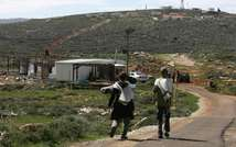File picture shows Israeli settlers in the illegal outpost of Esh Kodesh near the West bank village of Tormusayya, on March 5, 2008 ( AFP/Menahem Kahana )
