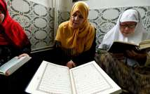 Mourshidates, female religious guides appointed by the Algerian religious affairs ministry to spread the good word of Islam and a message of tolerance, read the Koran, Islam's holy book, at the Ennidal mosque in the Algerian capital, Algiers, on February (AFP)