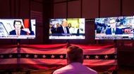 credits/photos : A man watches election coverage at the US embassy election party in Tel Aviv on November 8, 2016